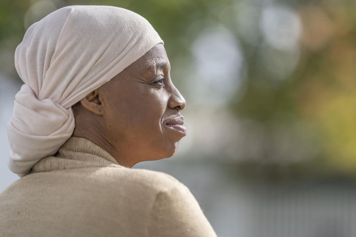 African American woman with cancer enjoying time outside