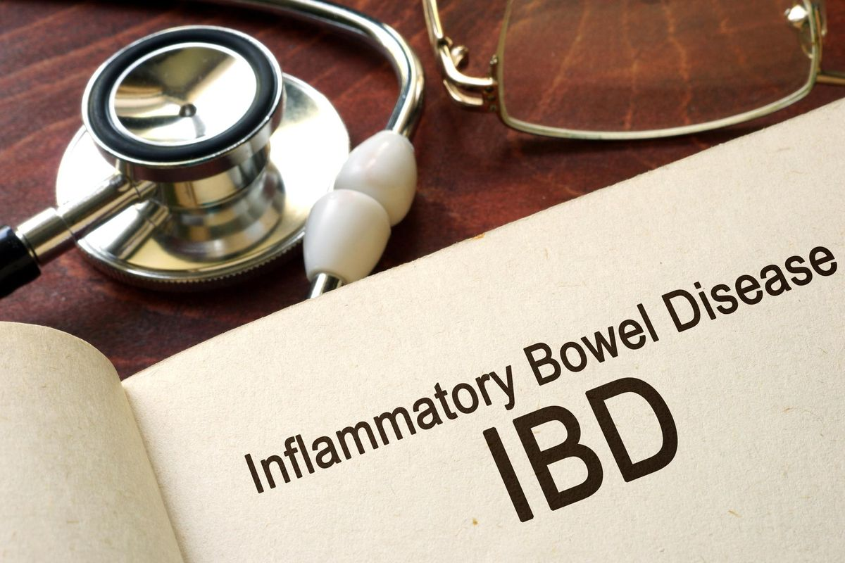 Book with words inflammatory bowel disease IBD on a table