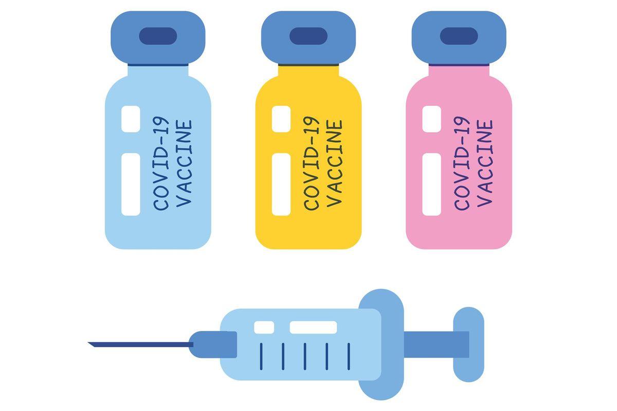 COVID-19 vaccine vial bottles and medical syringe