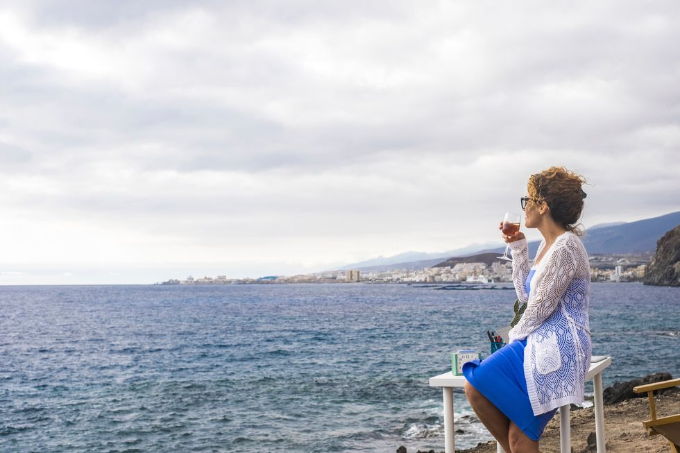 woman looking out at the water
