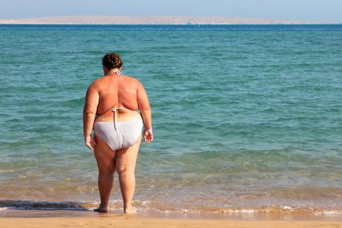 obese woman on the beach