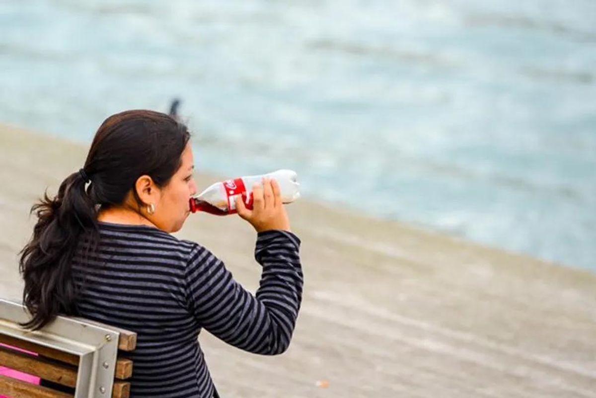 mature woman drinking soda