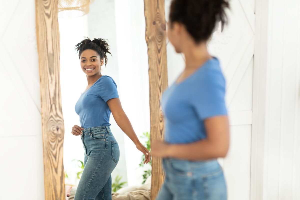 Joyful African American Girl After Slimming Looking In Mirror