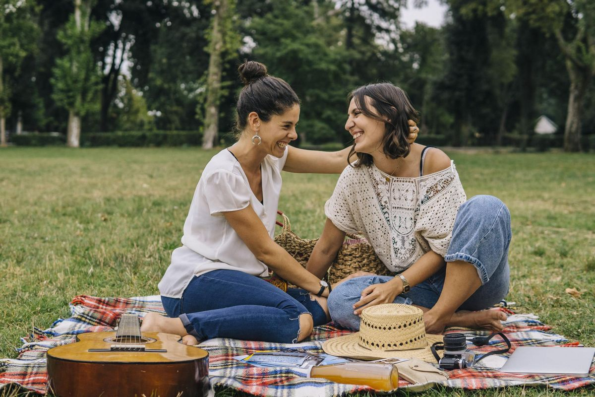 Lesbian couple relaxing outdoors in a park