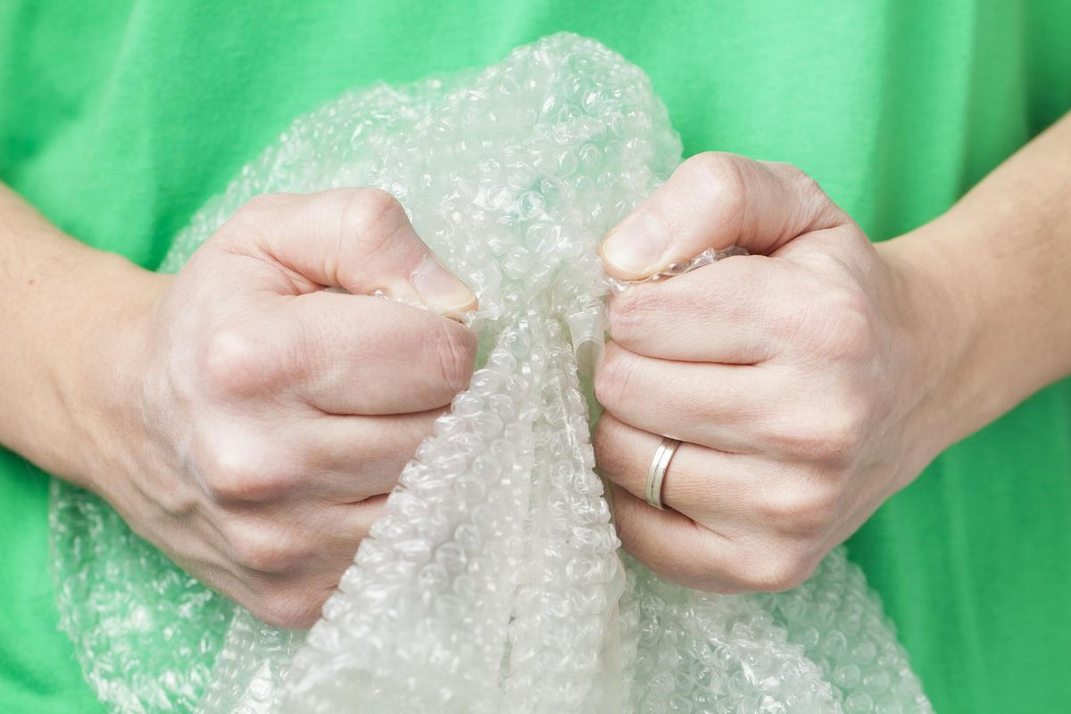 Man holding bubble wrap