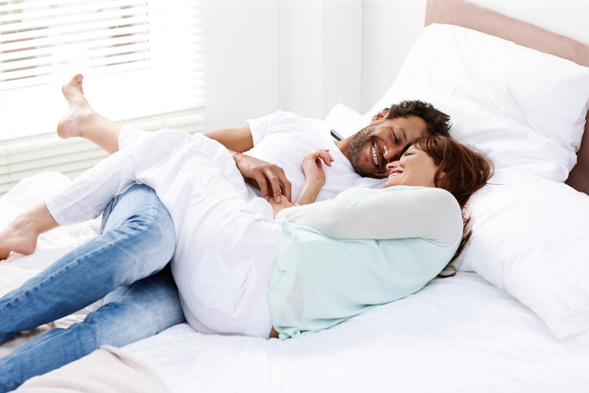 Couple in romantic mood on bed