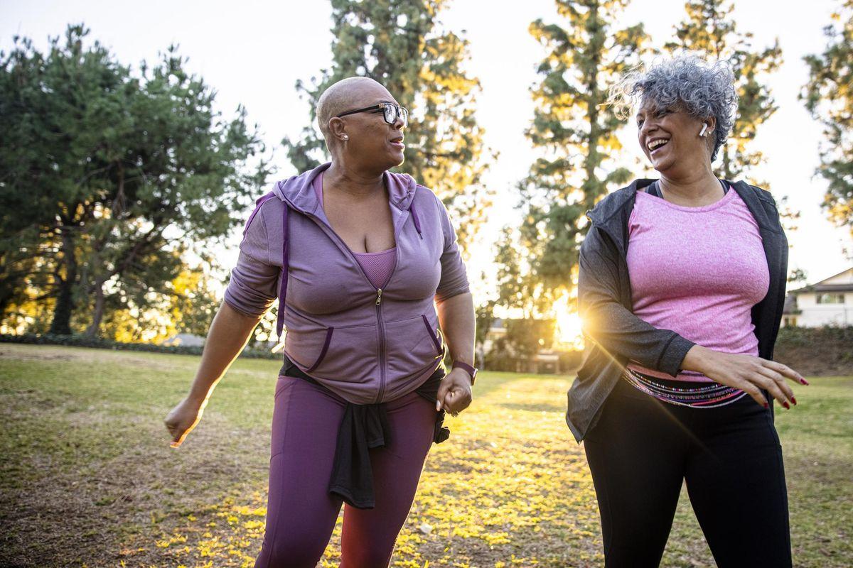 Two black woman walking
