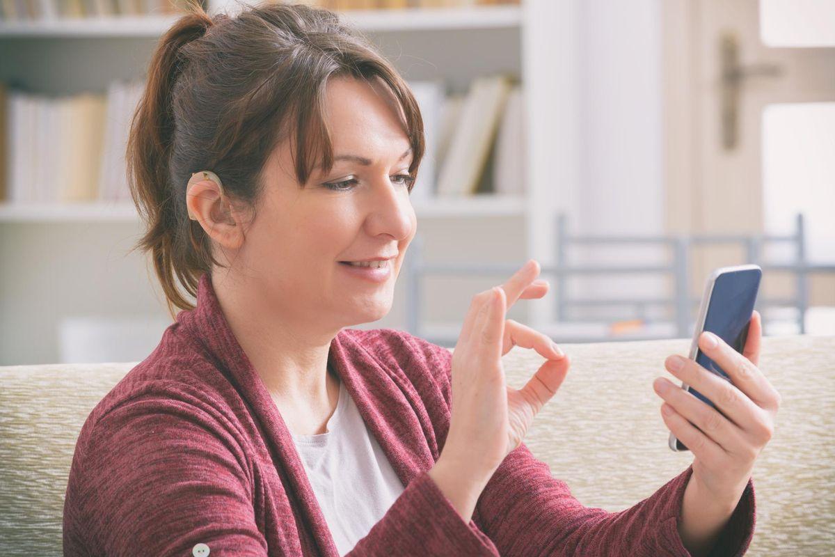 Deaf woman using smartphone