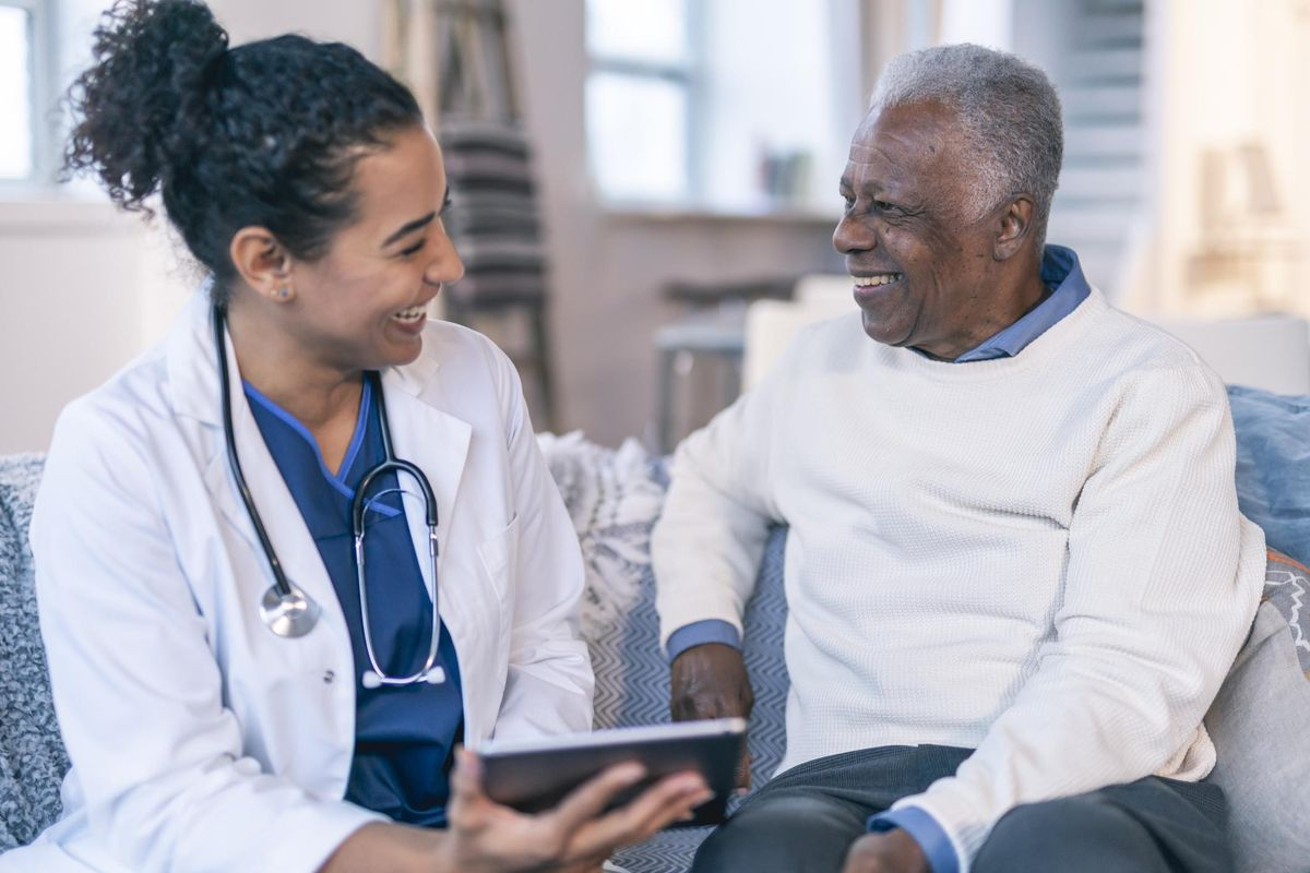 Female doctor meeting with senior patient