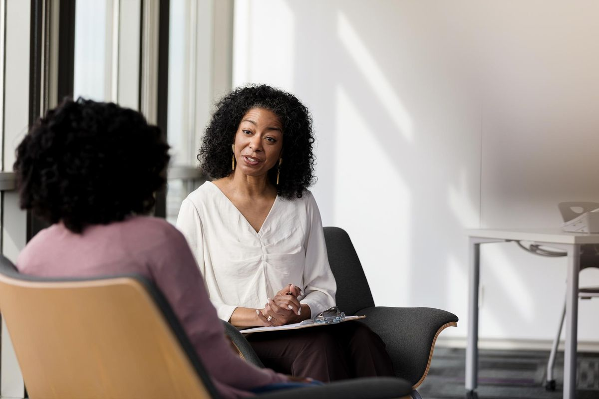 Female counselor talks with female patient