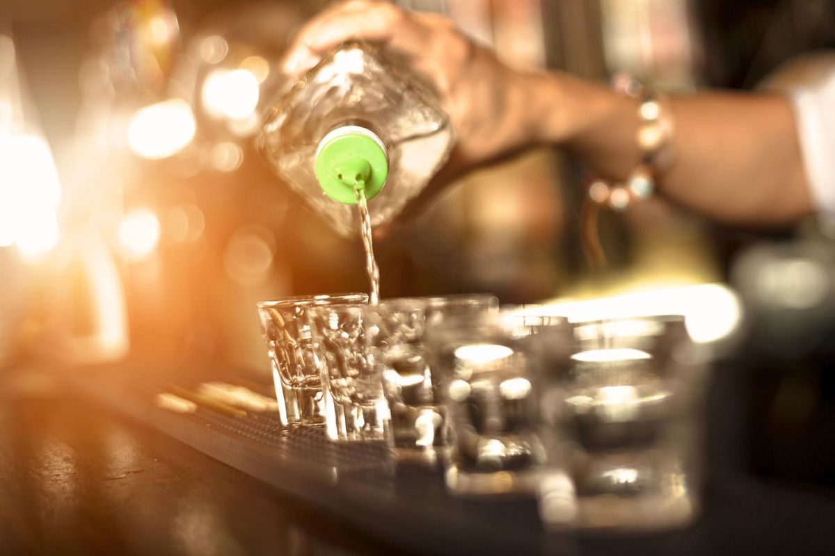 Close up of a bartender pouring alcohol