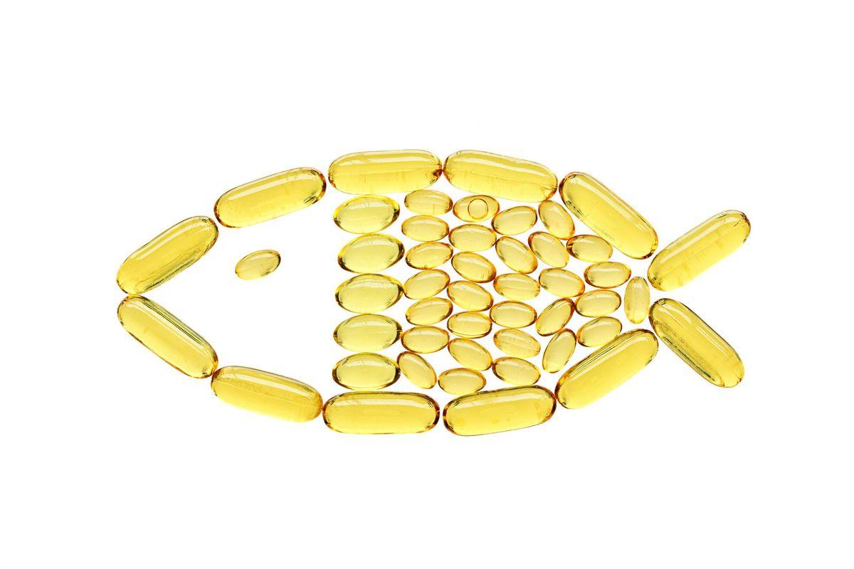 Transparent yellow medical capsules in fish shape