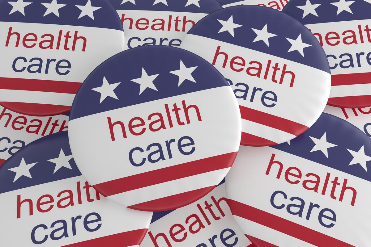 Pile of Health Care Buttons With US Flag