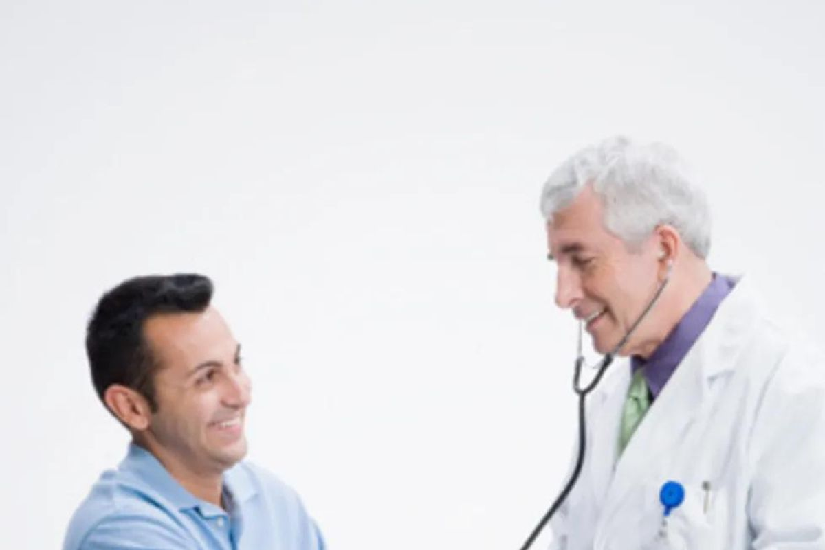 man getting his blood pressure taken by doctor