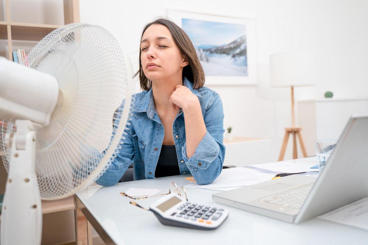 Portrait of one woman refreshing during summer heatwave