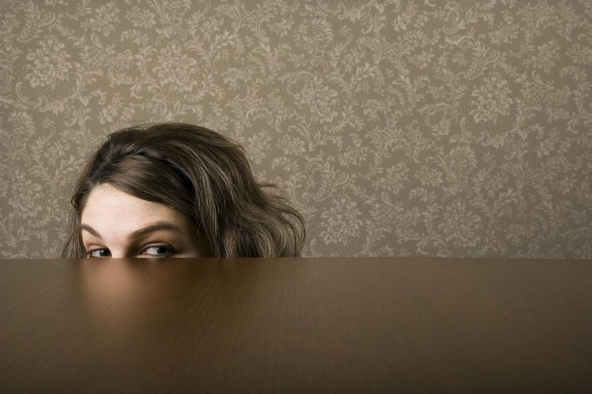woman hiding most of her face