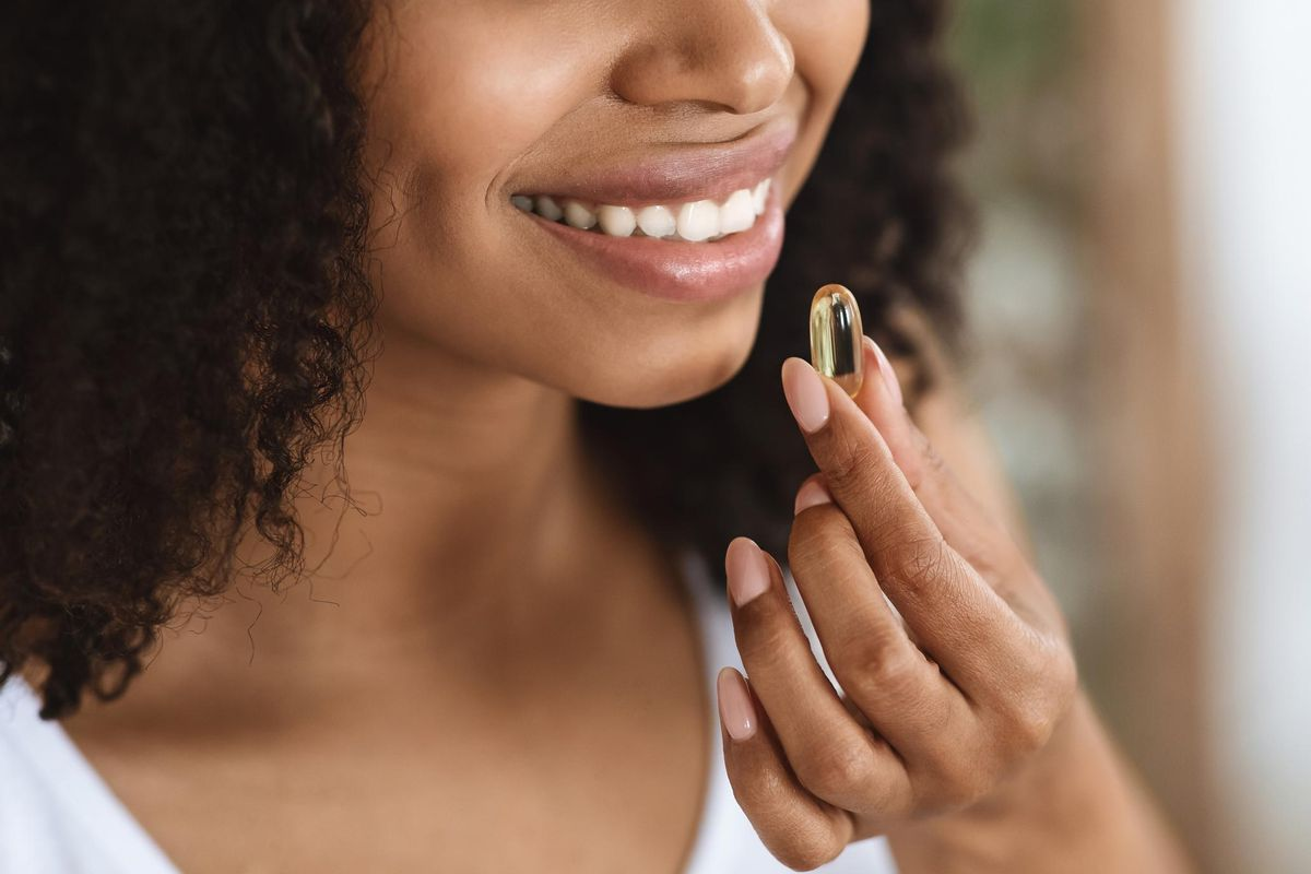woman taking a vitamin