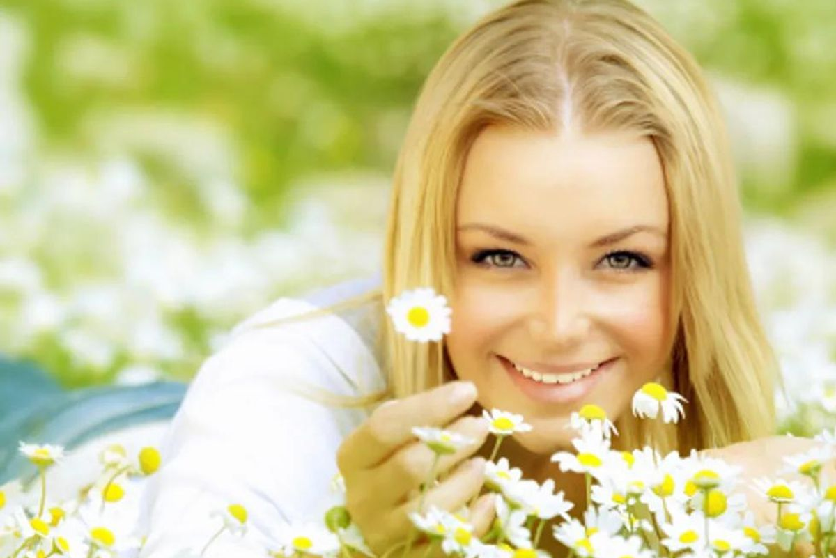 woman in a bed of daisies