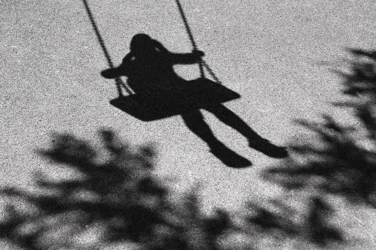 Girl on a swing shadow