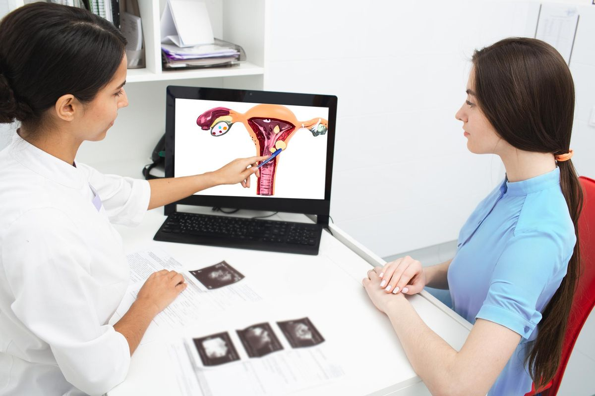 Gynecologist explains to a woman about a disease of the uterus
