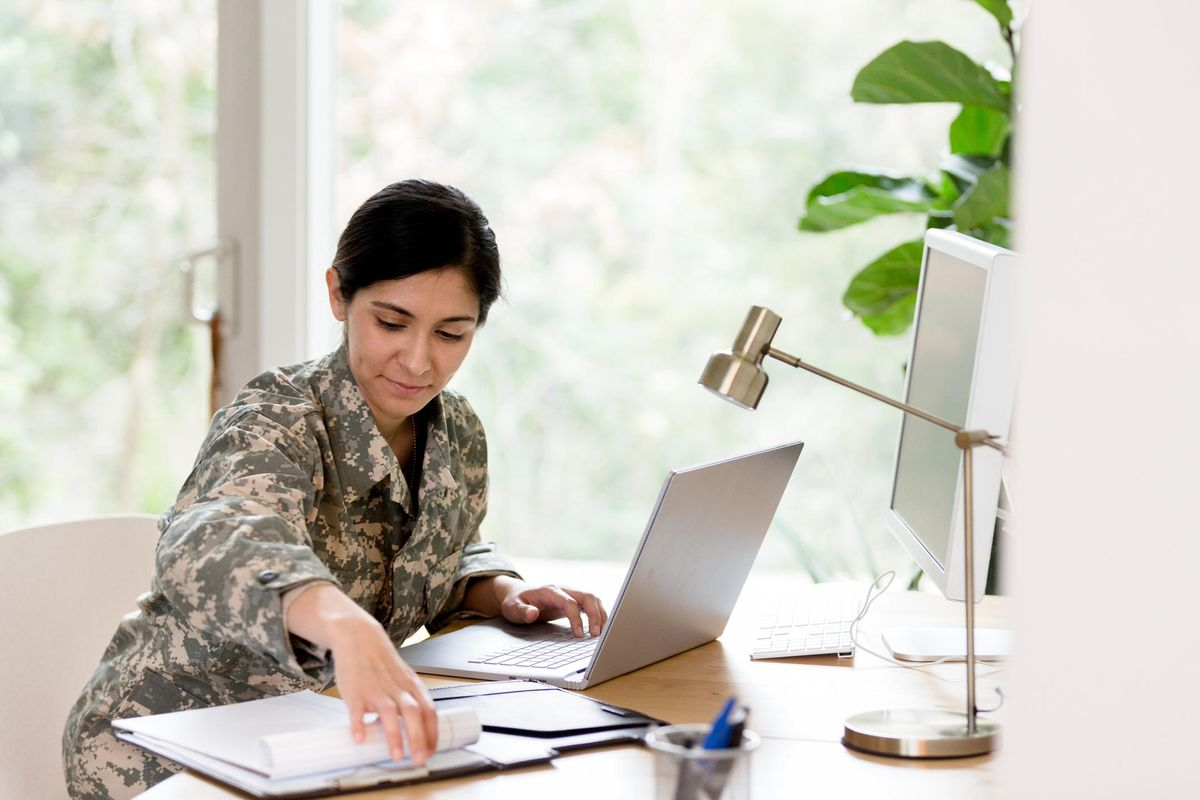 Female soldier works on home finances