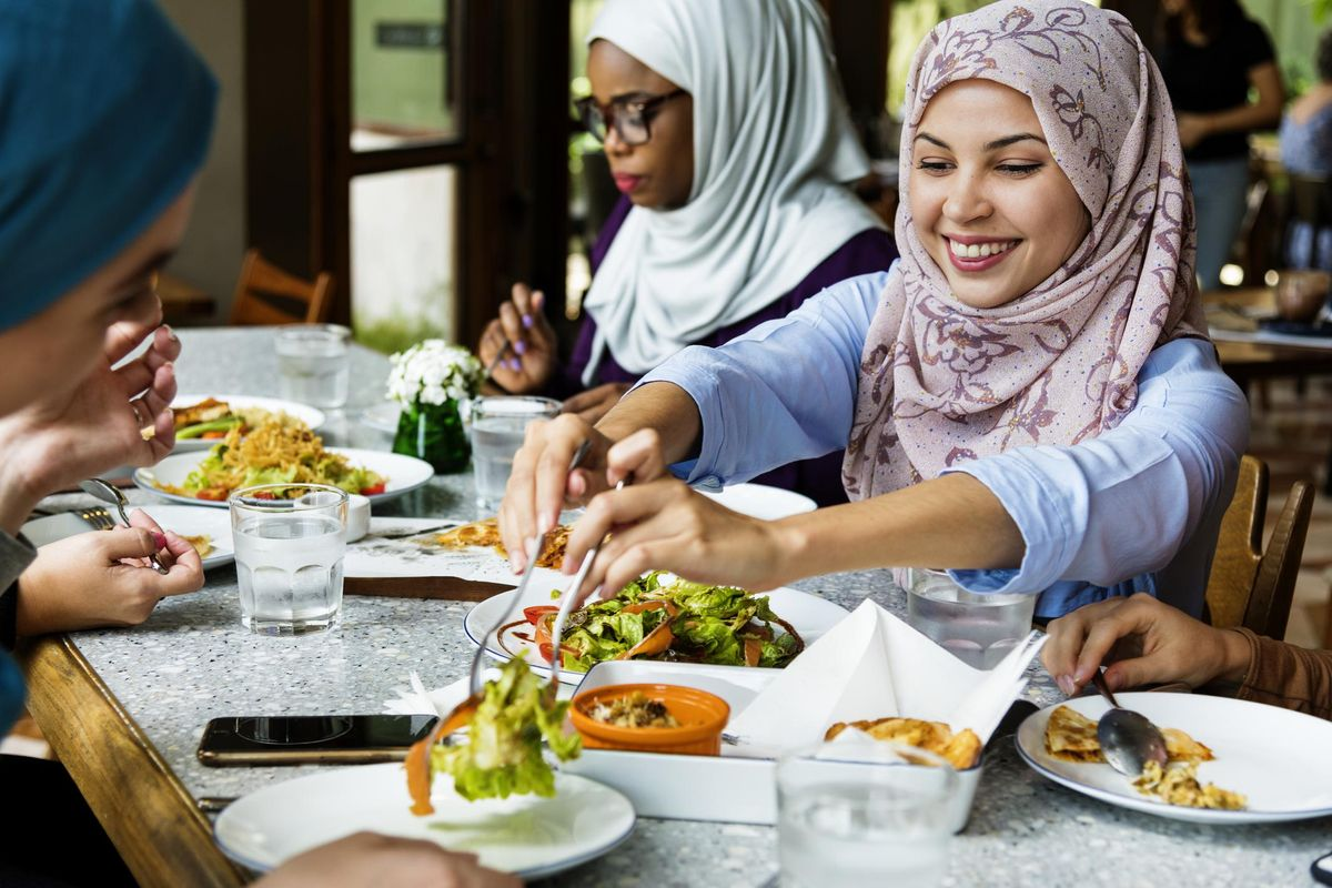 Islamic women friends dining together