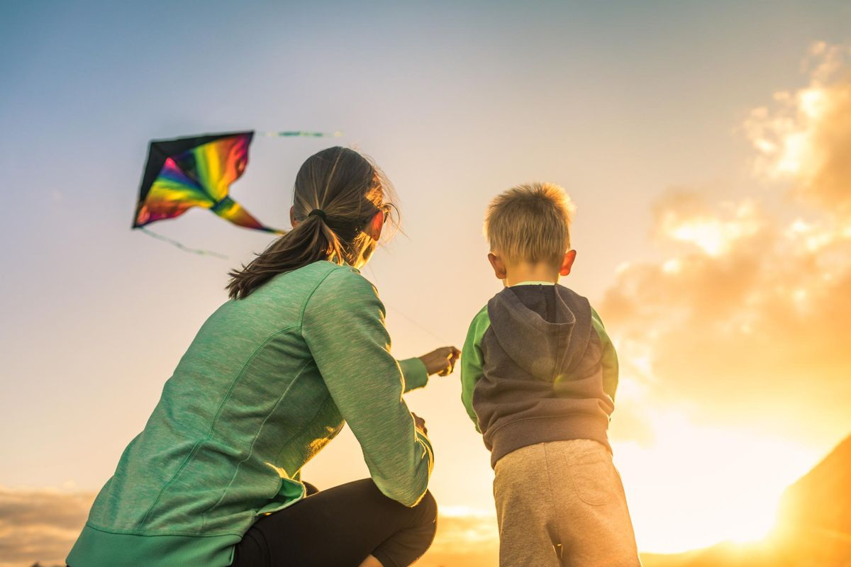Mother and son flying a kite