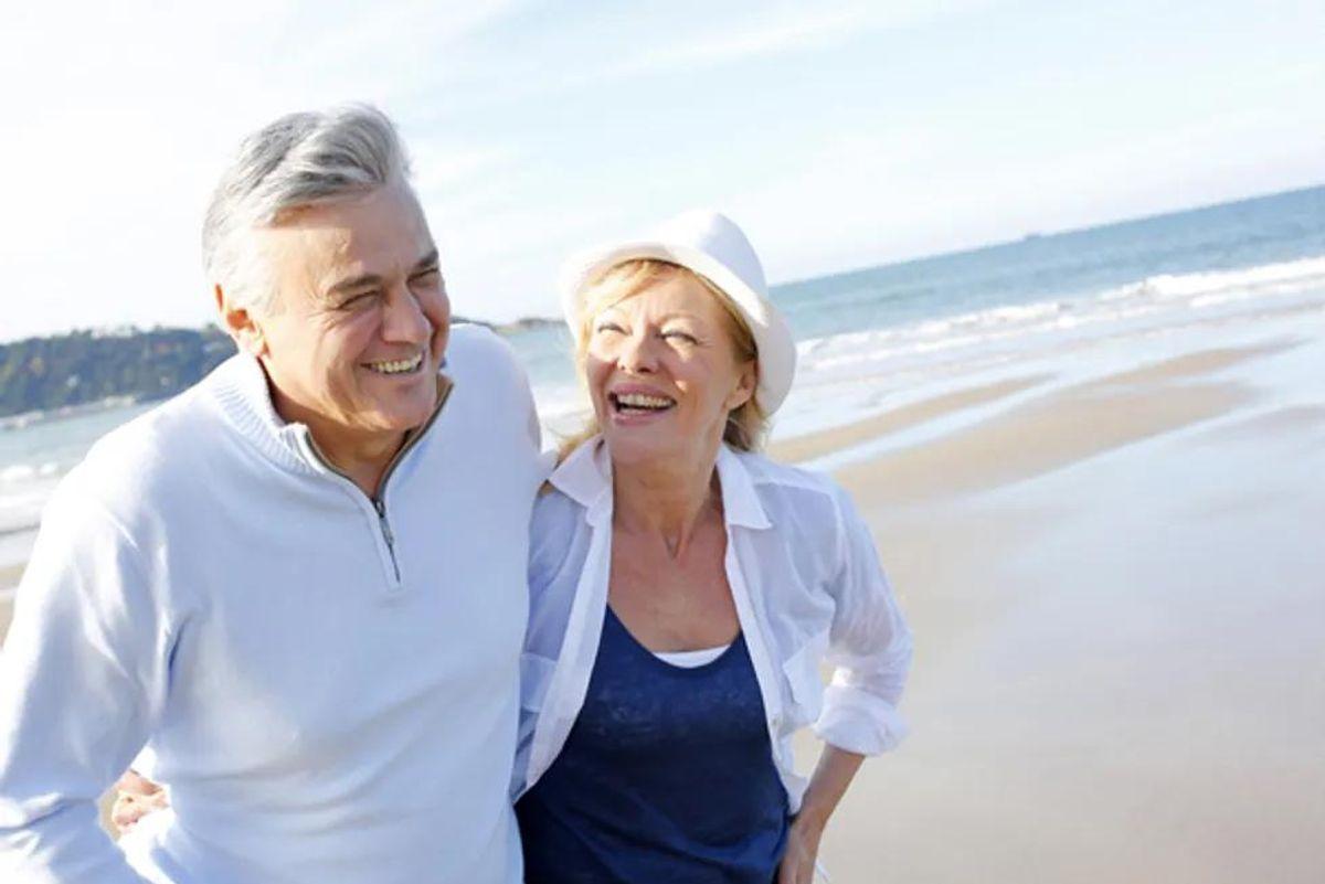 older happy couple on the beach