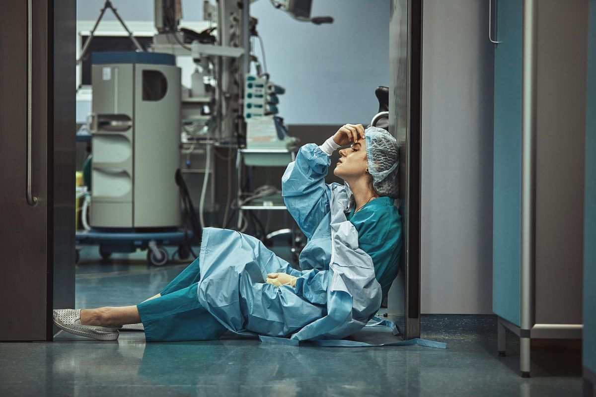 oman surgeon looking fatigued after surgery