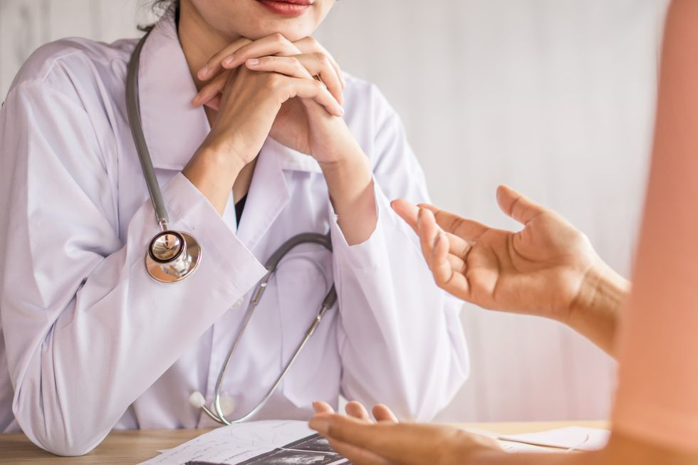 patient speaking with their doctor