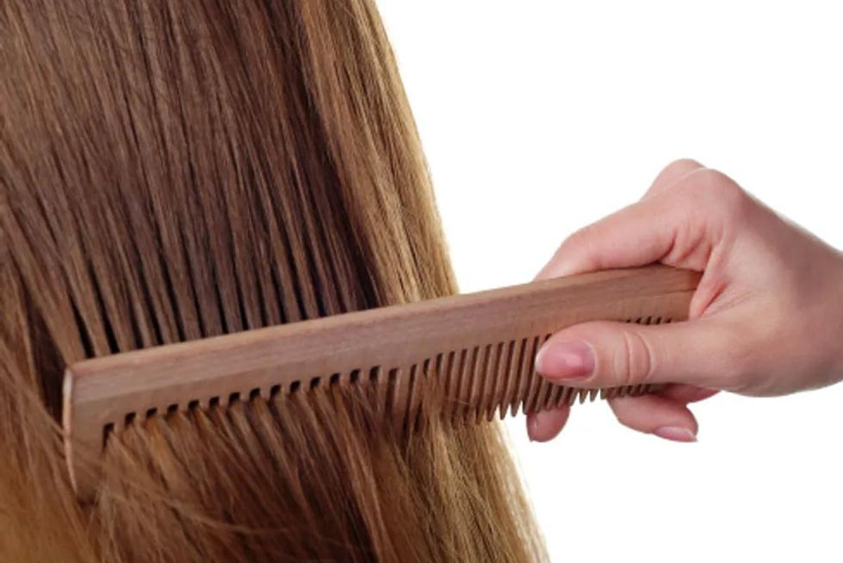 person combing hair