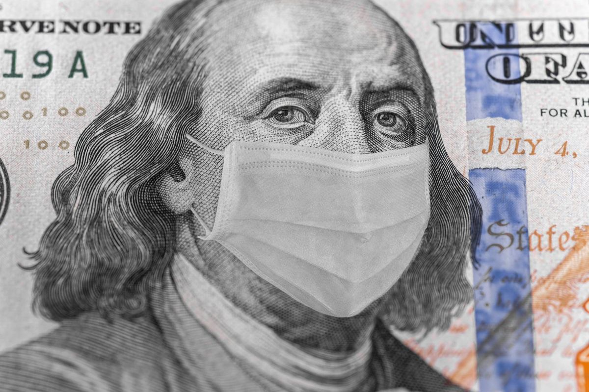 Photo illustration of Ben Franklin in a mask on a dollar 100 bill