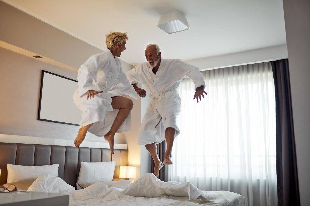 Senior Couple Having Fun in Hotel Room