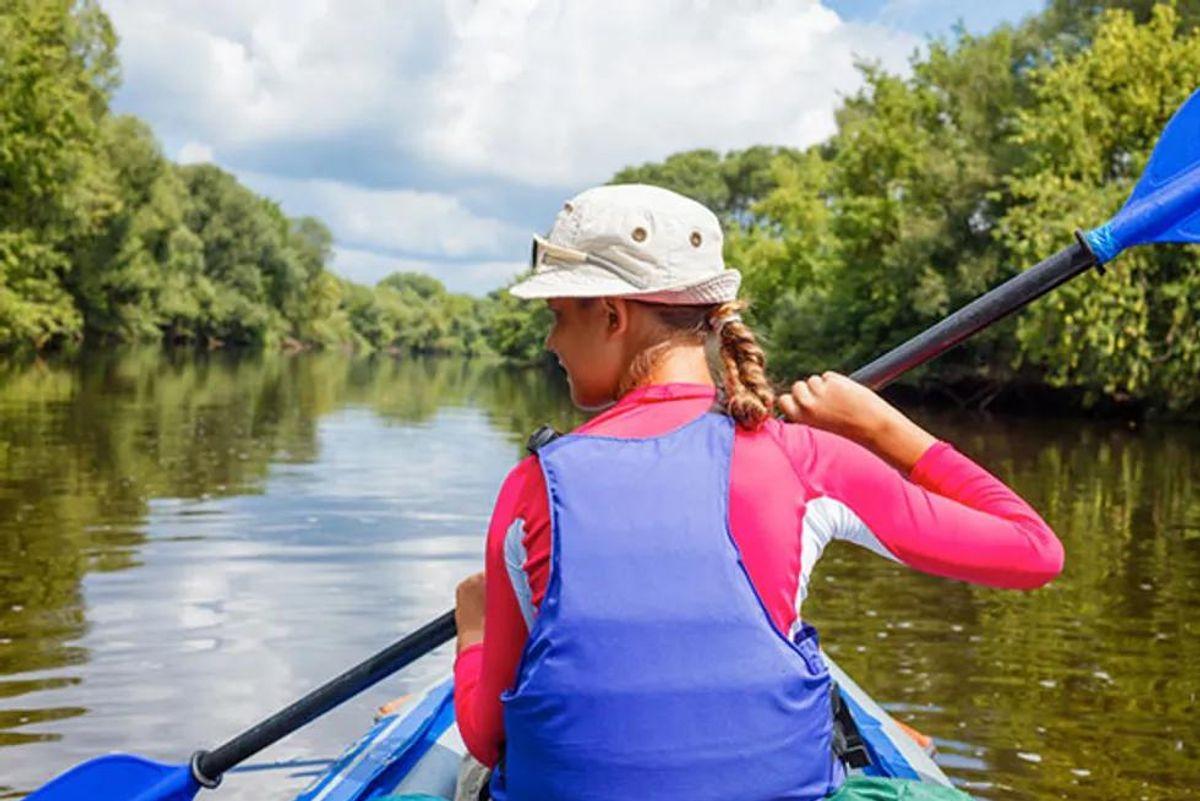 teenager kayaking