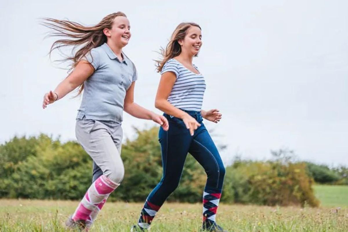 teens running in a field