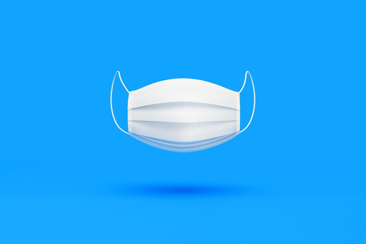 White Protective Mask over Blue Background