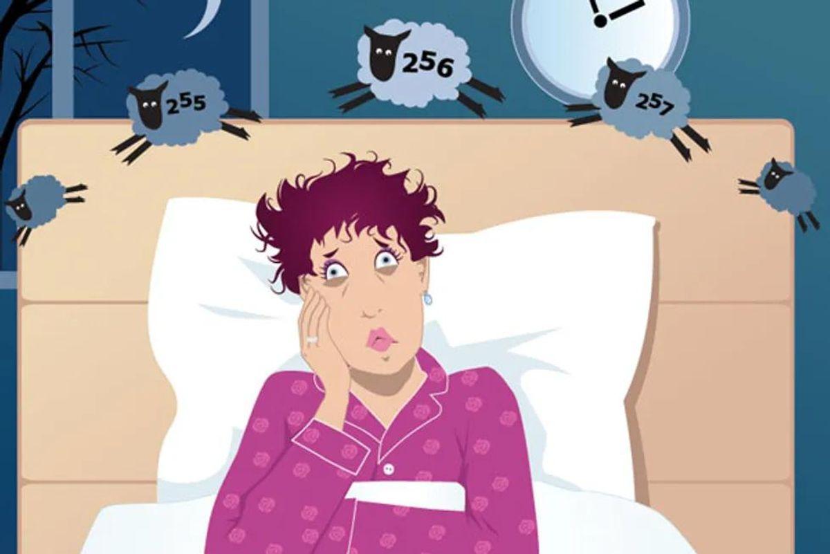 woman counting sheep at night