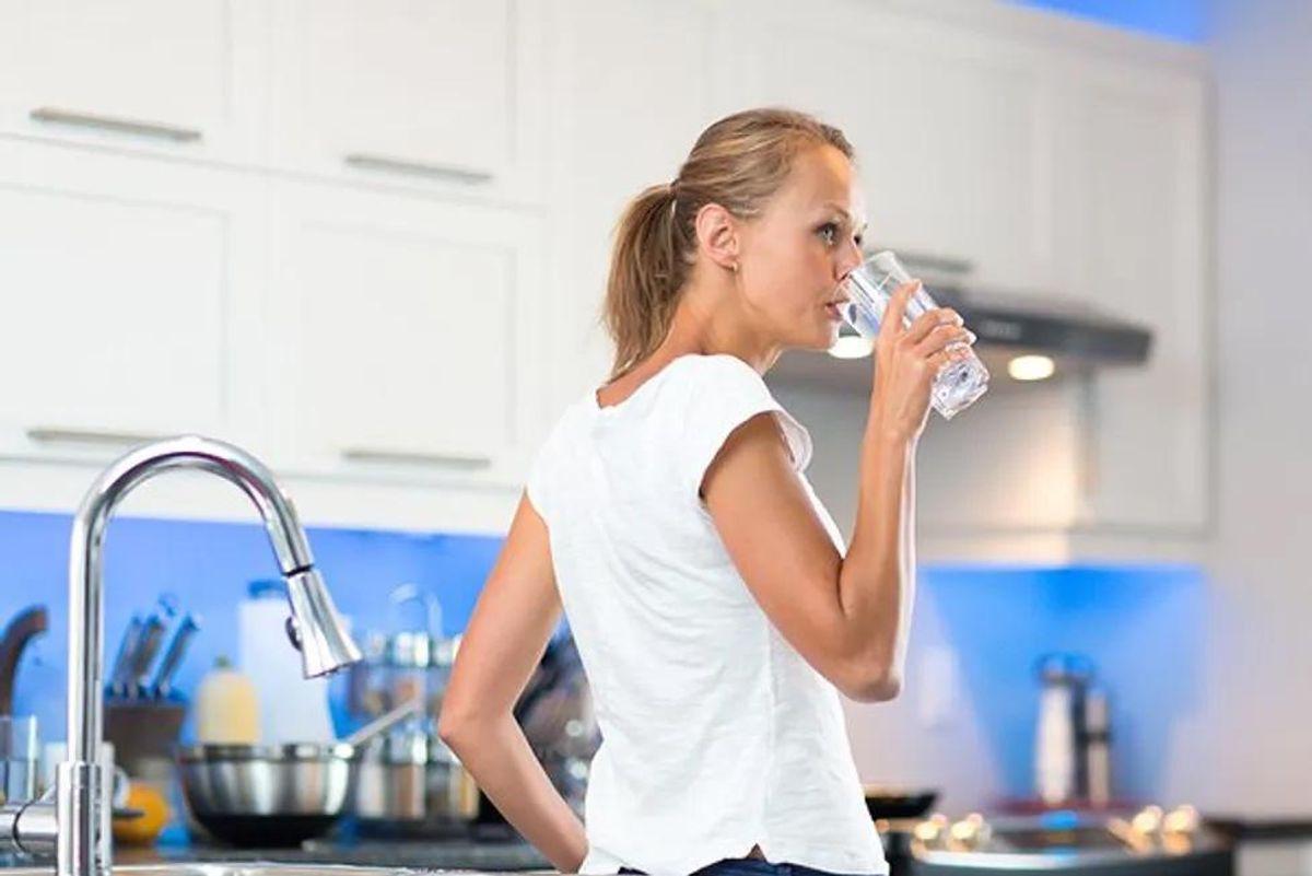 woman drinking tap water