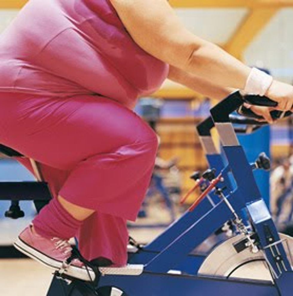 woman on a stationery bike