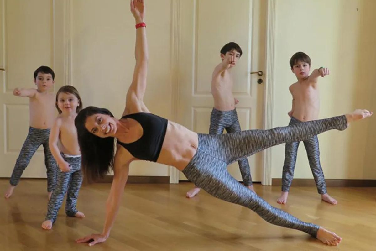 woman working out with her 4 kids