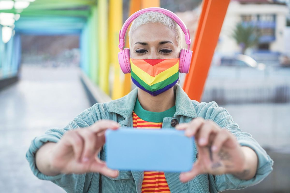 Young gay woman taking selfie
