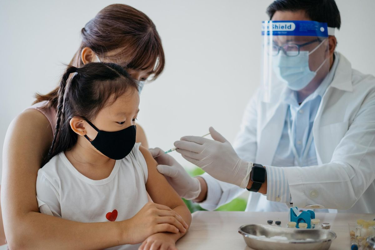 Young girl getting a vaccine