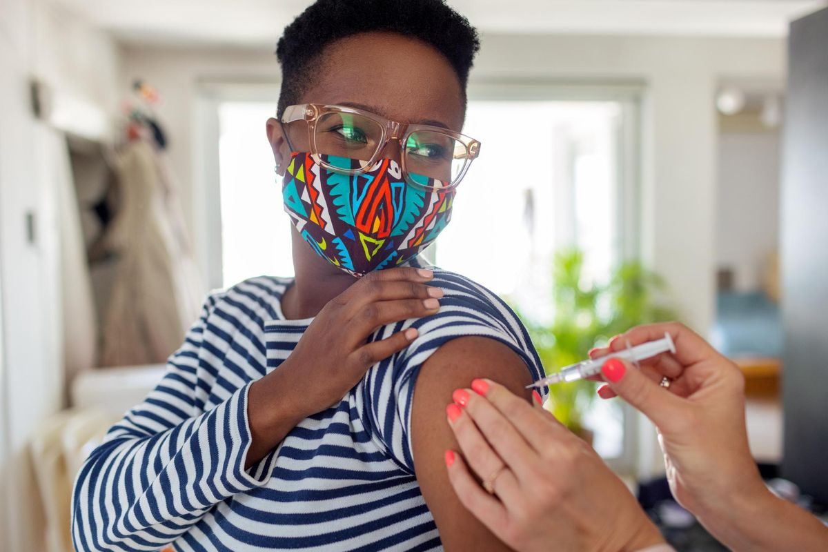 Young Woman Receiving Coronavirus Vaccine