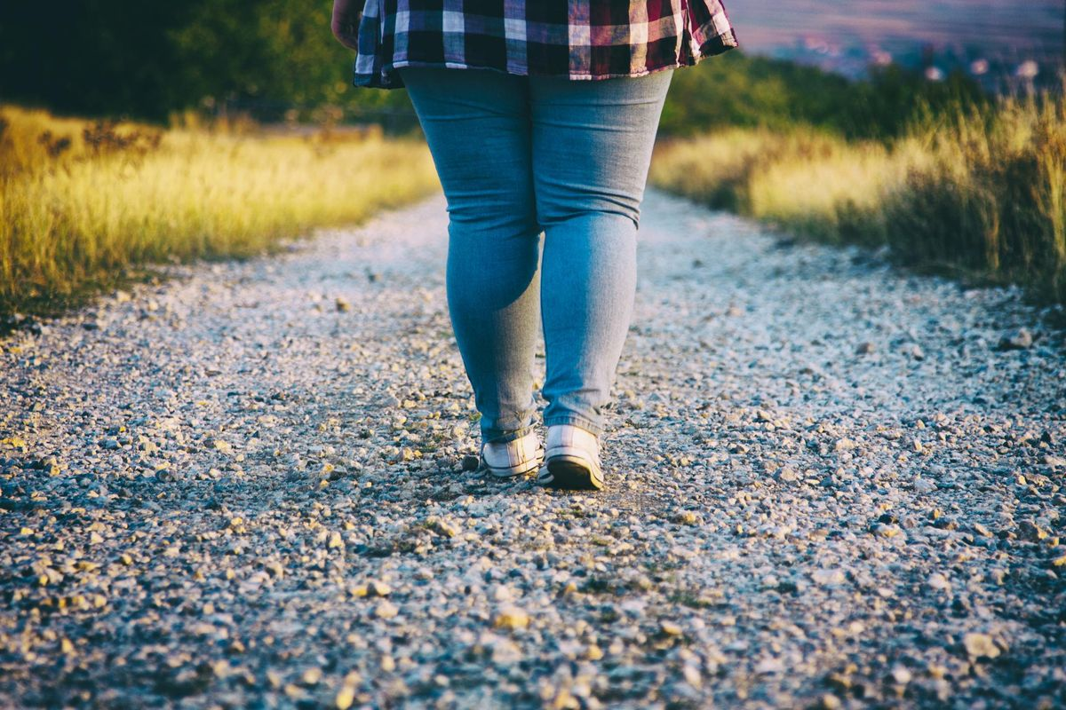 Young woman walking on country road